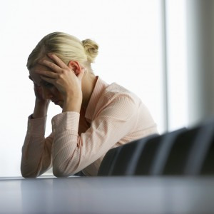 Stressed Businesswoman --- Image by © Royalty-Free/Corbis
